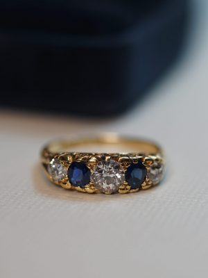 Sapphire Diamond Swirl Engagement Ring Front March 20